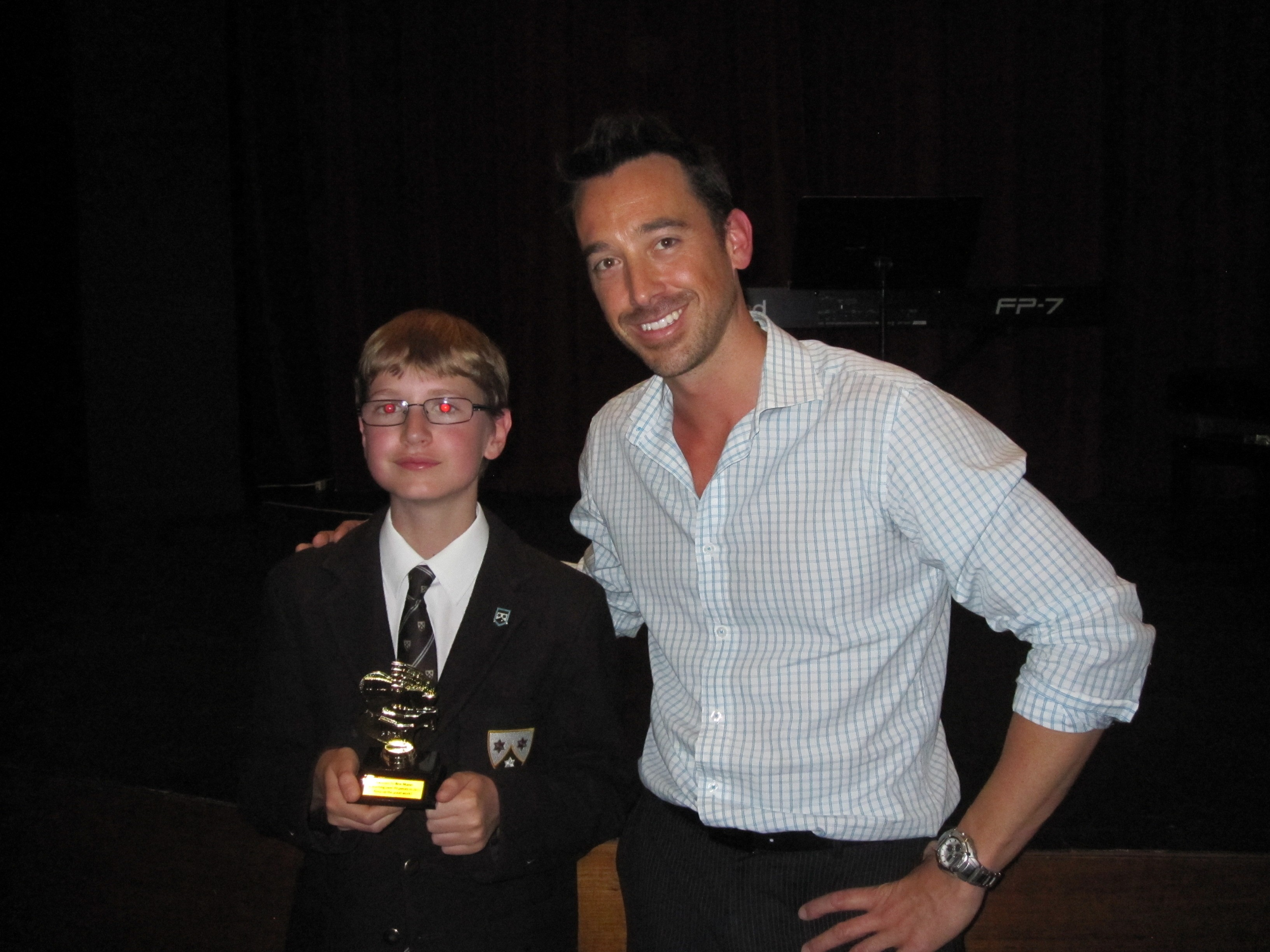 Ben with his award and Tim Topham.